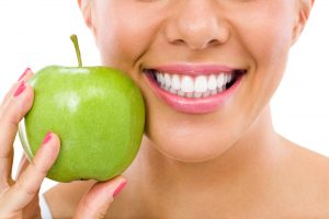 woman-smile-green-apple